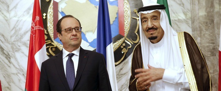 French President Francois Hollande (L) stands beside Saudi Arabian King Salman bin Abdelaziz al-Saud during the the Gulf cooperation council summit in Riyadh on May 5. (CHRISTOPHE ENA/AFP/Getty Images)