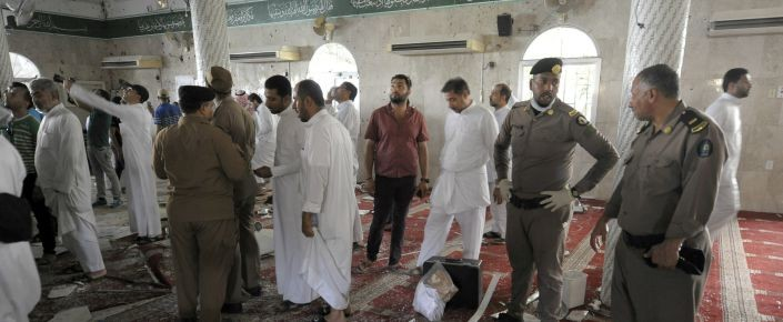 Saudi policemen gather around debris following a blast inside a mosque, in the mainly Shiite Saudi Gulf coastal town of Qatif, 400 kms east of Riyadh, on May 22, 2015. A suicide bomber targeted a Shiite mosque during Friday prayers in Kudeih in Shiite-majority Qatif district, the interior ministry said, with activists saying at least four worshippers were killed. AFP PHOTO / HUSSEIN RADWAN (Photo credit should read HUSSEIN RADWAN/AFP/Getty Images)