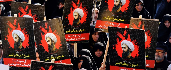Iranian women gather during a demonstration against the execution of prominent Shia Muslim cleric Nimr al-Nimr (portrait) by Saudi authorities, at Imam Hossein Square in the capital Tehran on January 4, 2016. Tensions between Iran and its Sunni Arab neighbors reached new heights as Saudi Arabia and Gulf allies cut or downgraded diplomatic ties with Tehran in a row over the execution of a Shia cleric.  (ATTA KENARE/AFP/Getty Images)