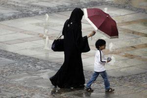 An Emirati family walking after a rain storm in Dubai, United Arab Emirates. (AP Photo/Kamran Jebreili)