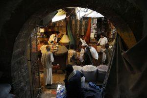 Yemenis shop at a market in the old city of Sanaa, Yemen, June 17, 2015. (AP Photo/Hani Mohammed)