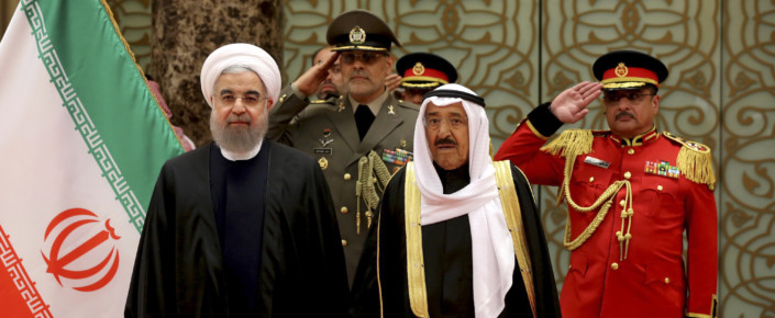 Iranian President Hassan Rouhani, left, is welcomed by Kuwaiti Emir Sheikh Sabah al-Ahmed al-Sabah.