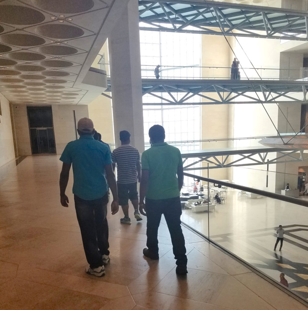 Male workers at the Museum of Islamic Art in Doha, Qatar