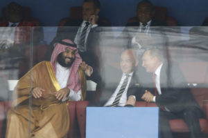 Saudi Arabia Crown Prince Mohammed bin Salman, left, FIFA President Gianni Infantino, center, and Russian President Vladimir Putin