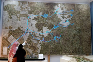 Saudi architect Usamah Shehatah points at a map in the offices of the Jeddah Development and Urban Regeneration Company in Jeddah, Saudi Arabia, Dec. 11, 2013. (AP Photo)