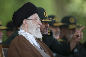 Iranian Supreme Leader Ayatollah Ali Khamenei listens to Revolutionary Guard commander Mohammad Ali Jafari during a graduation ceremony of a group of the guard's officers in Tehran, Iran, May 20, 2015. (Office of the Iranian Supreme Leader via AP)
