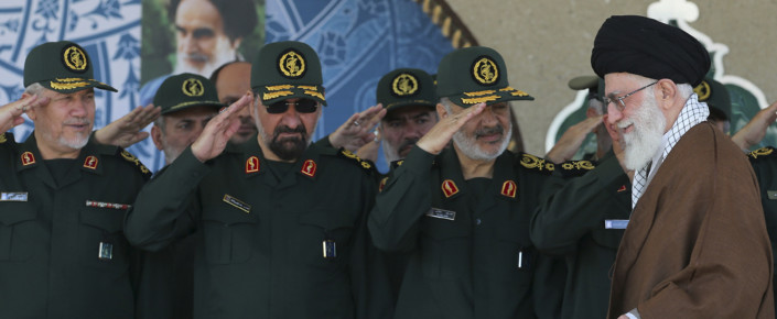 Iranian Supreme Leader Ayatollah Ali Khamenei, right, arrives at a graduation ceremony of the Islamic Revolutionary Guard Corps's officers, while deputy commander of the IRGC, Hossein Salami, second right, former IRGC commanders Mohsen Rezaei, second left, and Yahya Rahim Safavi salute him in Tehran, Iran, May 20, 2015. (Office of the Iranian Supreme Leader via AP)