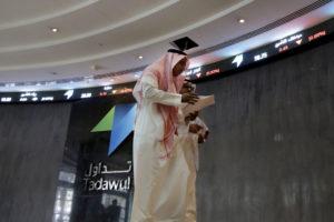 Saudi men walk at the Tadawul Saudi stock exchange in Riyadh, Saudi Arabia, June 15, 2015. (AP Photo/Hasan Jamali)