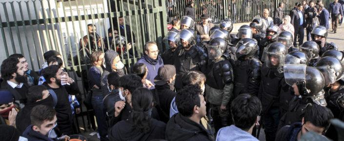Iranian police confront university student protestors in Tehran, Iran, Dec. 30, 2017. (AP Photo)